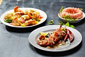 Three crustacean dishes: prawns with fruit, a ring of prawns and lobster