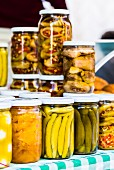 Pickle vegetables in glass jars on a market stand in Beirut, Lebanon