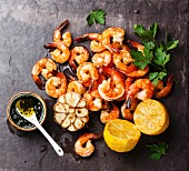 Prawns Shrimps roasted and served on stone slate with lemon and garlic