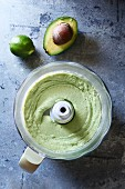 Avocado and lime dressing in a food processor