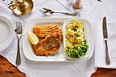 Baked carp with potato and lamb's lettuce