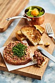 Beef tartare with toasted bread and salad