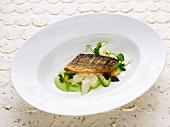 Asparagus risotto with pan-fried bass on parsley broth