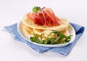 Gnocco fritto (fried Italian flatbreads) with cured ham and rocket