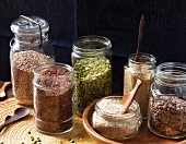 Lentils, rice, couscous, split peas, kasha, and red quinoa in preserving jars