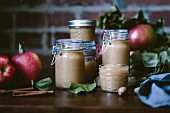 Glass jars filled with homemade apple sauce