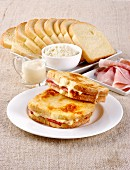 Toasted ham sandwiches covered in bechamel sauce