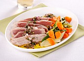 Marinated tuna with capers and red onions