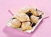 Sweet bread dough tortelli with jam and blueberries (Italy)