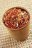 An Indian spice mixture in a ceramic cup