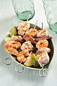 Fish and prawn kebabs with lime