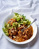 Chicken legs in paprika and white wine sauce with courgette ribbons
