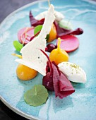 Goats' cheese chantilly cream with pickled red and yellow beetroot