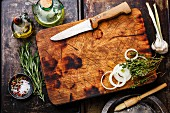 Wooden chopping board background with Seasoning and herbs