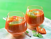 Strawberry and papaya drink with kiwi puree