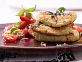 Potato and kohlrabi fritters with a tomato salad