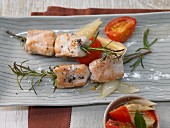 Rabbit skewers with rosemary and tomato