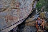 A man looking at rock paintings,Botswana