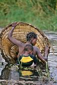 Hambukushu woman and child fishing