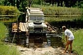 Vehicle crossing backwater,Botswana