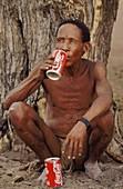 Dzu bushman drinking Coca Cola