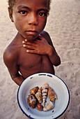Boy selling sea shells,Madagascar