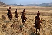 Himba women in landscape,Namibia