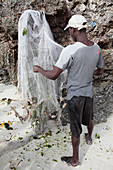 Fisherman removing fish from a net