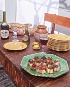 Crostini with tapenade on a rustic table
