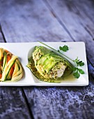 Fish wrapped in cucumber and served with colourful pasta