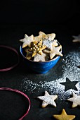 Christmas gingerbread stars in a blue ceramic bowl