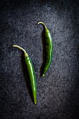 Two green chilli peppers (seen from above)