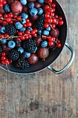 Blueberries, gooseberries, redcurrants and blackberries in a bowl