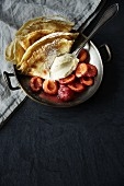 Pancakes with plum compote and vanilla ice cream