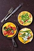 Assorted mini frittatas (cherry tomato and basil, pea and chilli pepper and asparagus and Parmesan)