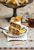 A slice of carrot layer cake with mascarpone icing and chai caramel