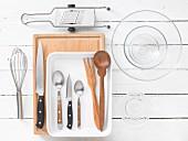 Kitchen utensils for the preparation of falafel, yoghurt dip and courgette salad
