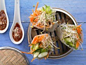 Steamed Asian wraps with sesame ginger sauce