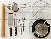 Kitchen utensils for making a melon and yoghurt cake with a biscuit base