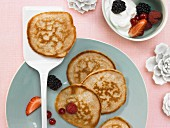 Whole grain buttermilk pancakes with quark cream and berries