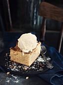 A piece of apple tart with vanilla ice cream