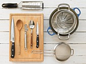 Kitchen utensils for making minestrone with meatballs and vegetables