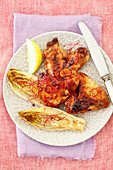 Grilled chicken wings with baked chicory