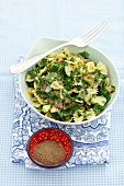 Farfalle with spinach, courgette and salami