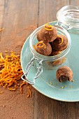 Vegan chocolate and orange truffles in a glass jar