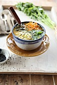 Asian miso soup with raw vegetables and coriander