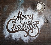 Merry Christmas written in icing sugar