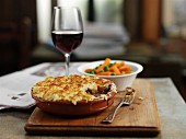 Cheesy Cumberland pie with carrots and peas
