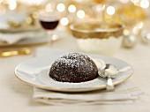 Christmas pudding on a festive table