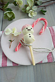 Stollen cake pop snowmen covered in white chocolate
